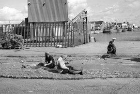Fishermen repairing nets near Dublin, August 2010
